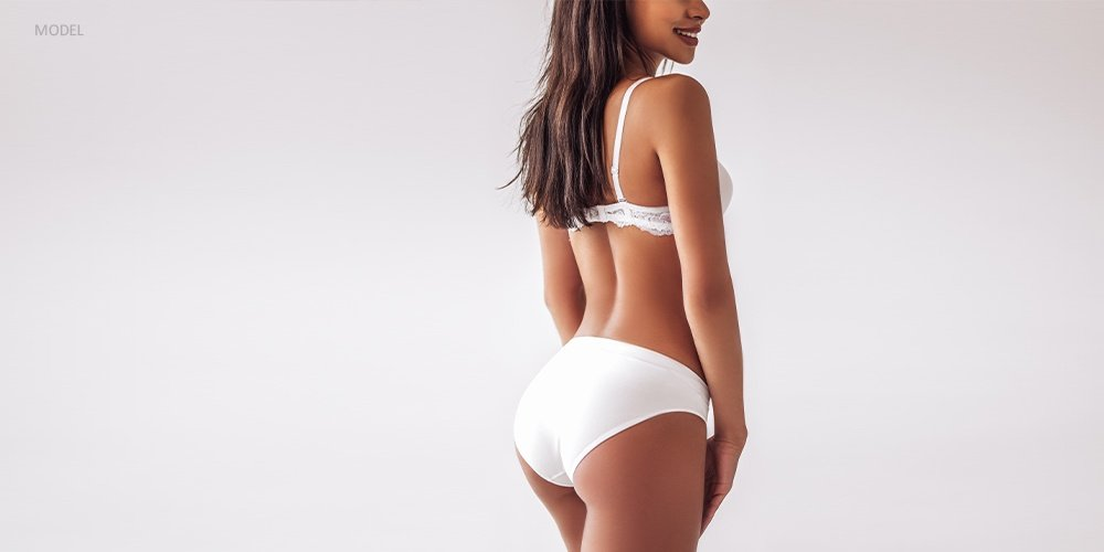 Back View of Curvaceous Woman in White Undergarments
