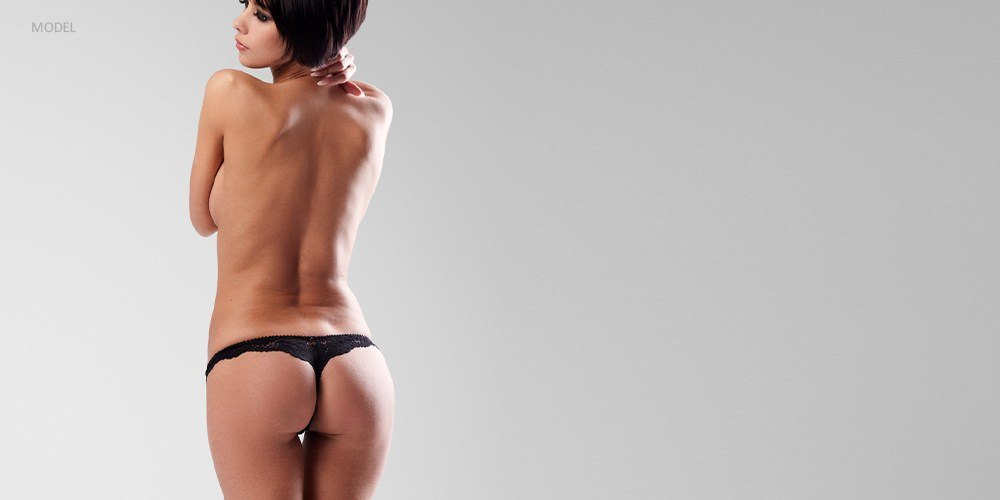Back View of Woman in Black Underwear
