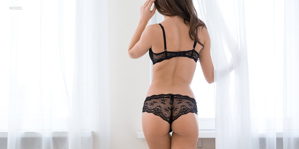 Back View of Thin and Curvy Woman in Black Lingerie