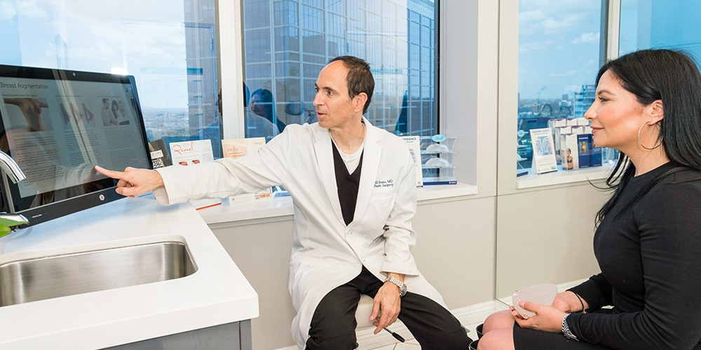 Dr. Bruno Answering A Patient's Questions in his West Hollywood Office